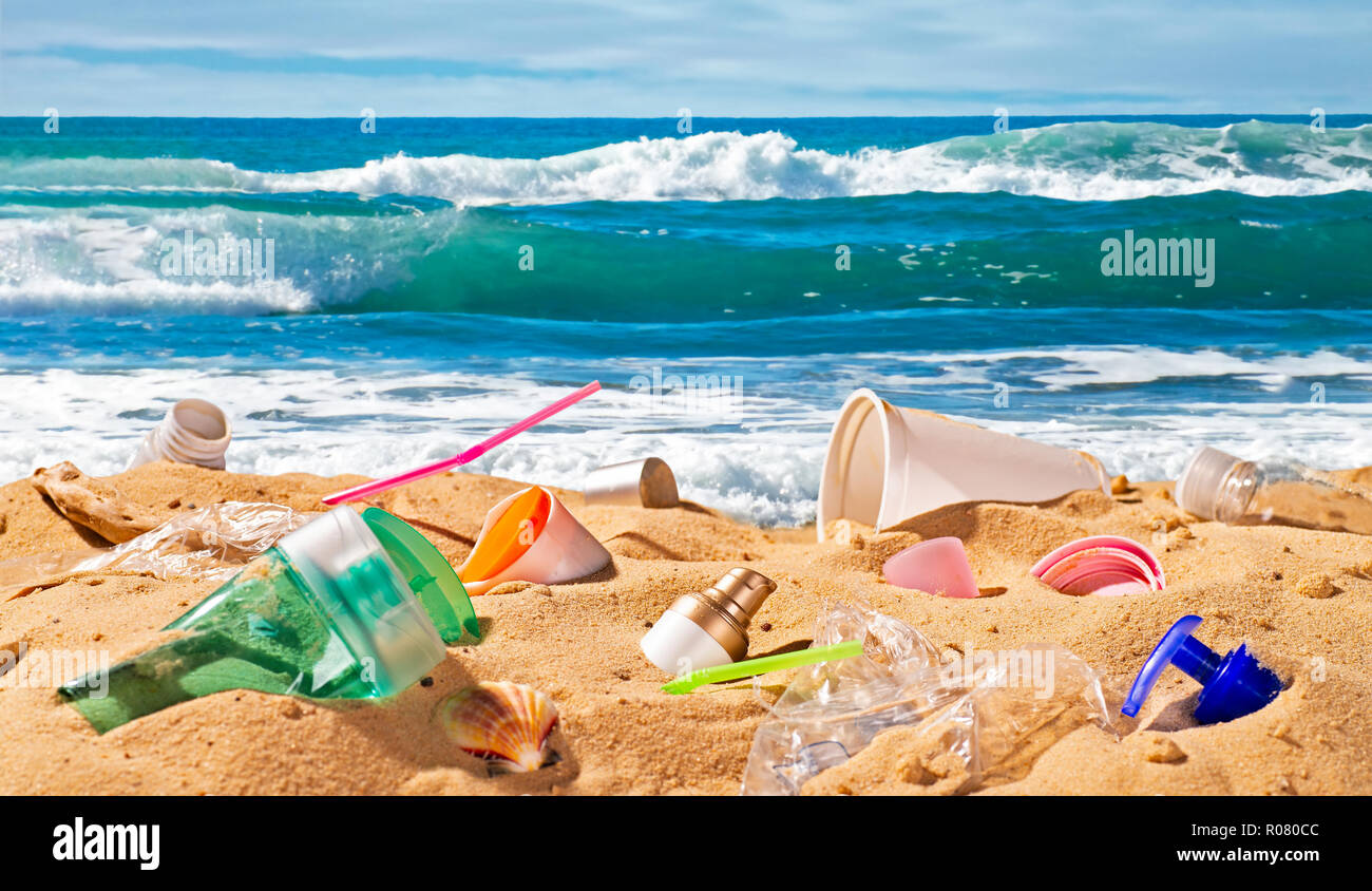 Plastic waste pollutes a wonderful sandy beach - Stock Image