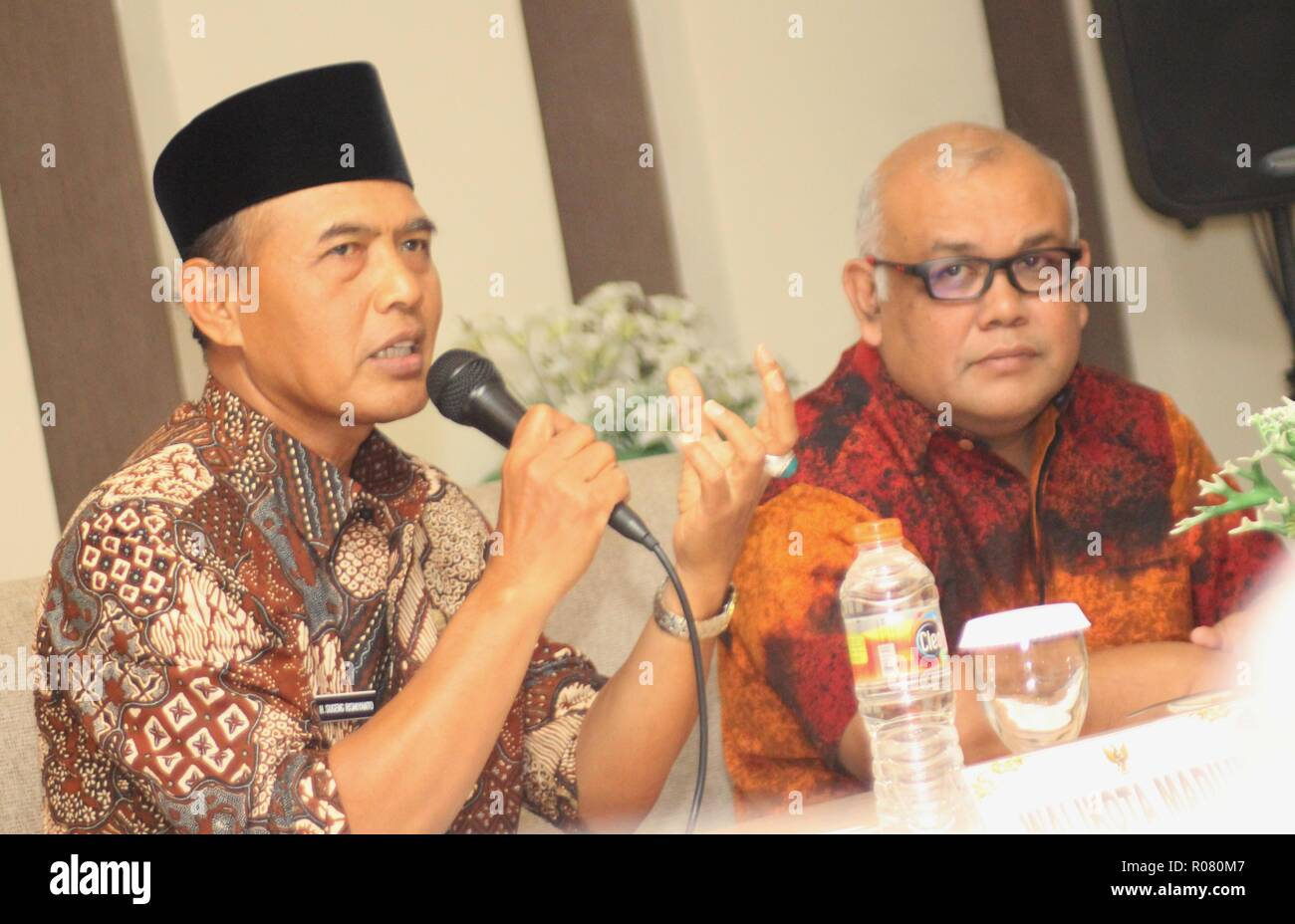 "Mayor of Madiun H. Sugeng Rismiyanto [left] accompanied by Head of Representative of Bank Indonesia Kediri, Djoko Raharto [right] delivered a presentation during a press release in the meeting room of one of the hotels in Madiun City. The press release is related Bank Indonesia will hold an Economic Seminar, Respondent Gathering, the Small and Medium Micro Business Festival and the National Payment Gate Campaign for three days. This is in the context of Regional Economic Development after Trans Java Toll Road and Double Track Railway "" (Photo by Ajun Ally/Pacific Press) - Stock Image"