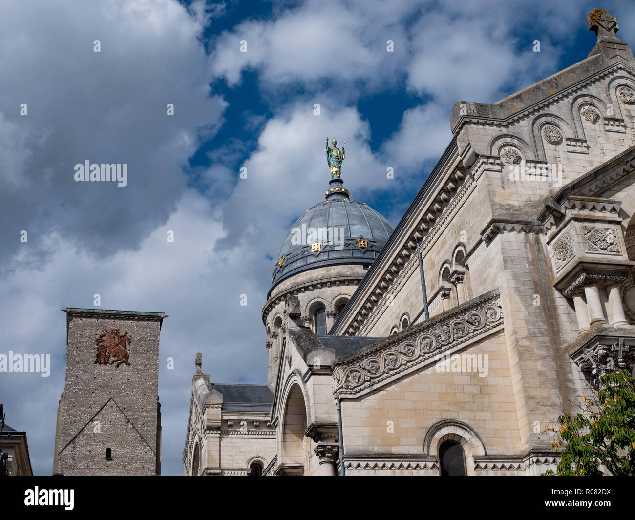 Statue above the basilica of St Martin. It's a Roman Catholic basilica dedicated to Saint Martin of Tours, in France, on whose tomb it was built. - Stock Image