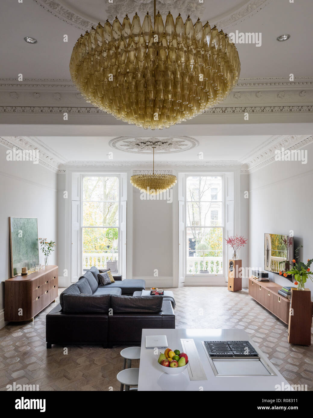 Modern open plan living area with chandelier Stock Photo
