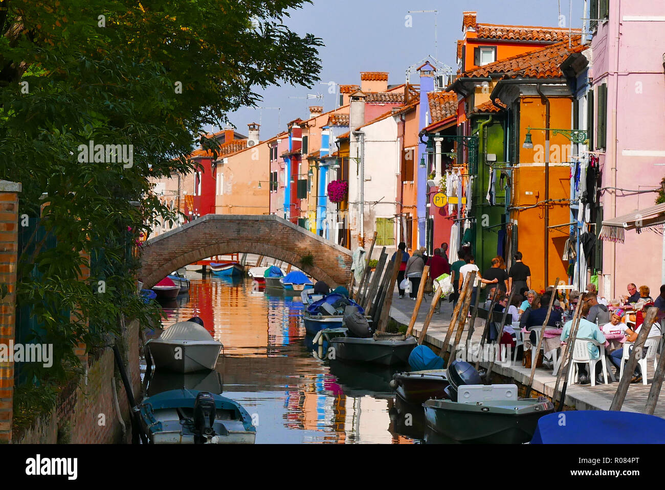 Canal view of the brightly painted houses on the island of Burano in the Venetian Lagoon Italy Stock Photo