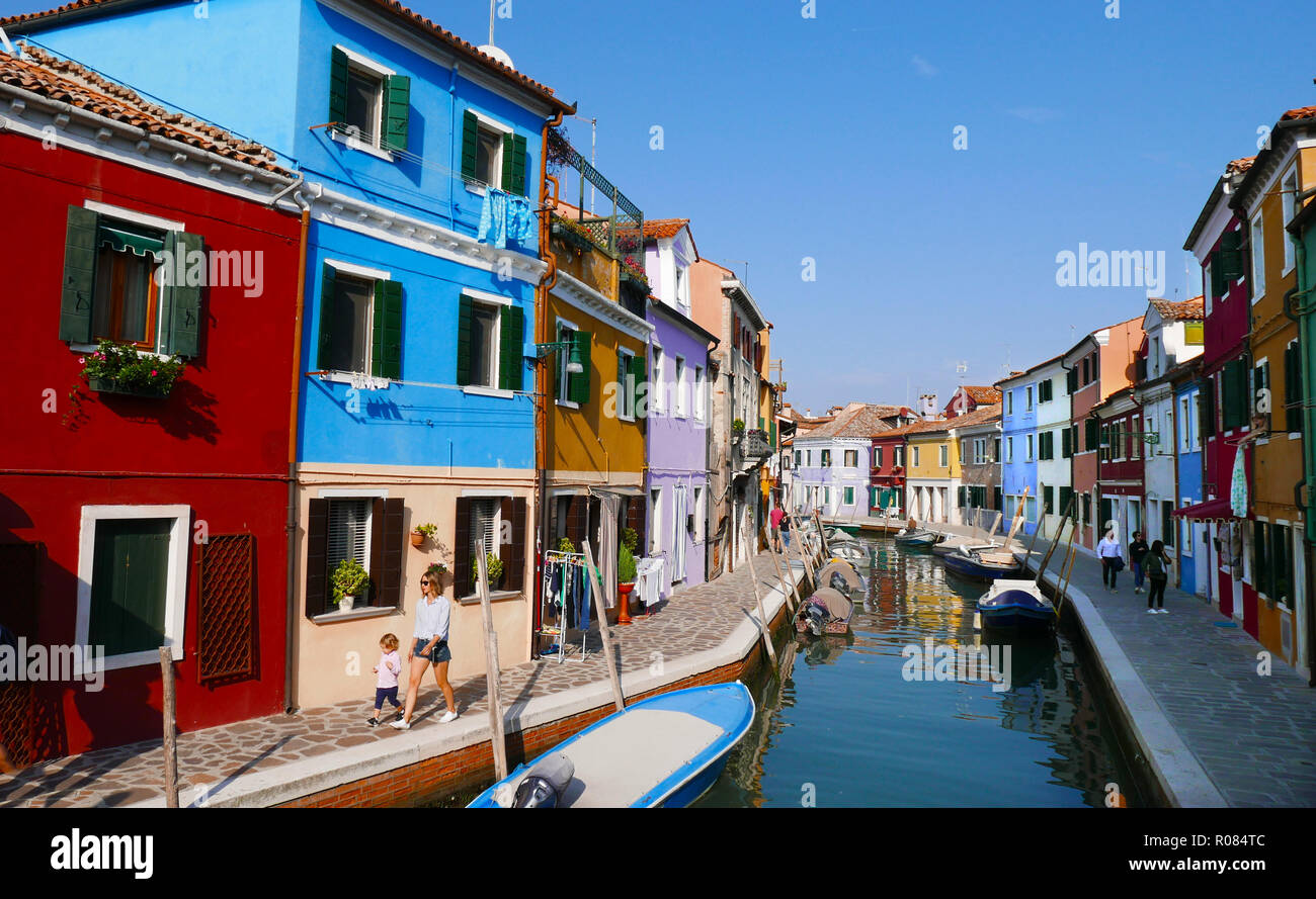 Canal view of the brightly painted house on the island of Burano in the Venetian Lagoon Stock Photo