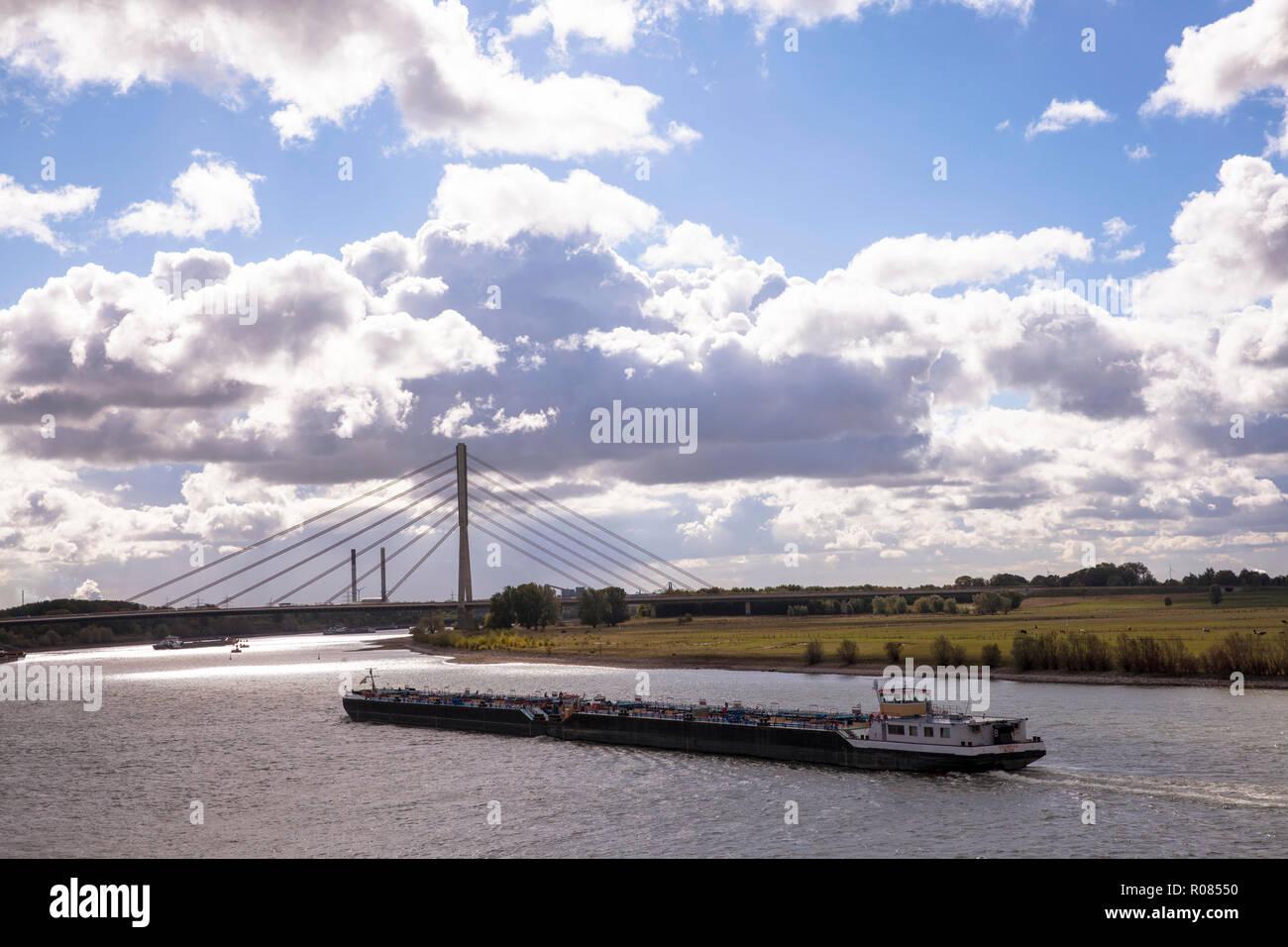 the Niederrhein bridge across the river Rhine, cargo vessel, Wesel, Germany.  die Niederrheinbruecke ueber den Rhein, Frachtschiff, Wesel, Deutschland - Stock Image