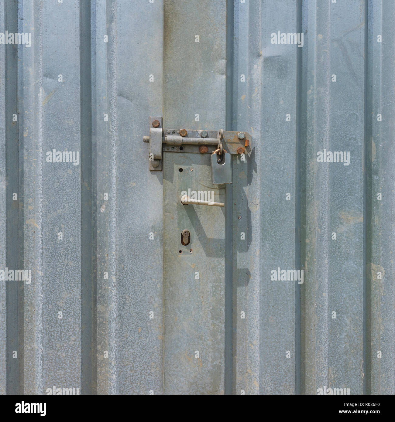 Padlocked doors of a lock-up self-storage shipping contained. Metaphor for secure, data security, virus protection etc. - Stock Image