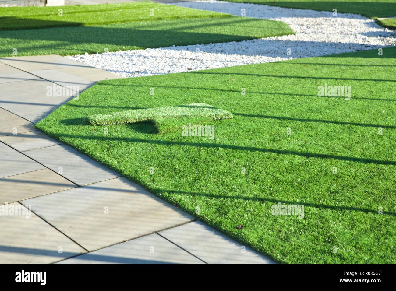Artificial lawn garden. Artificial grass, artificial lawn UK. - Stock Image