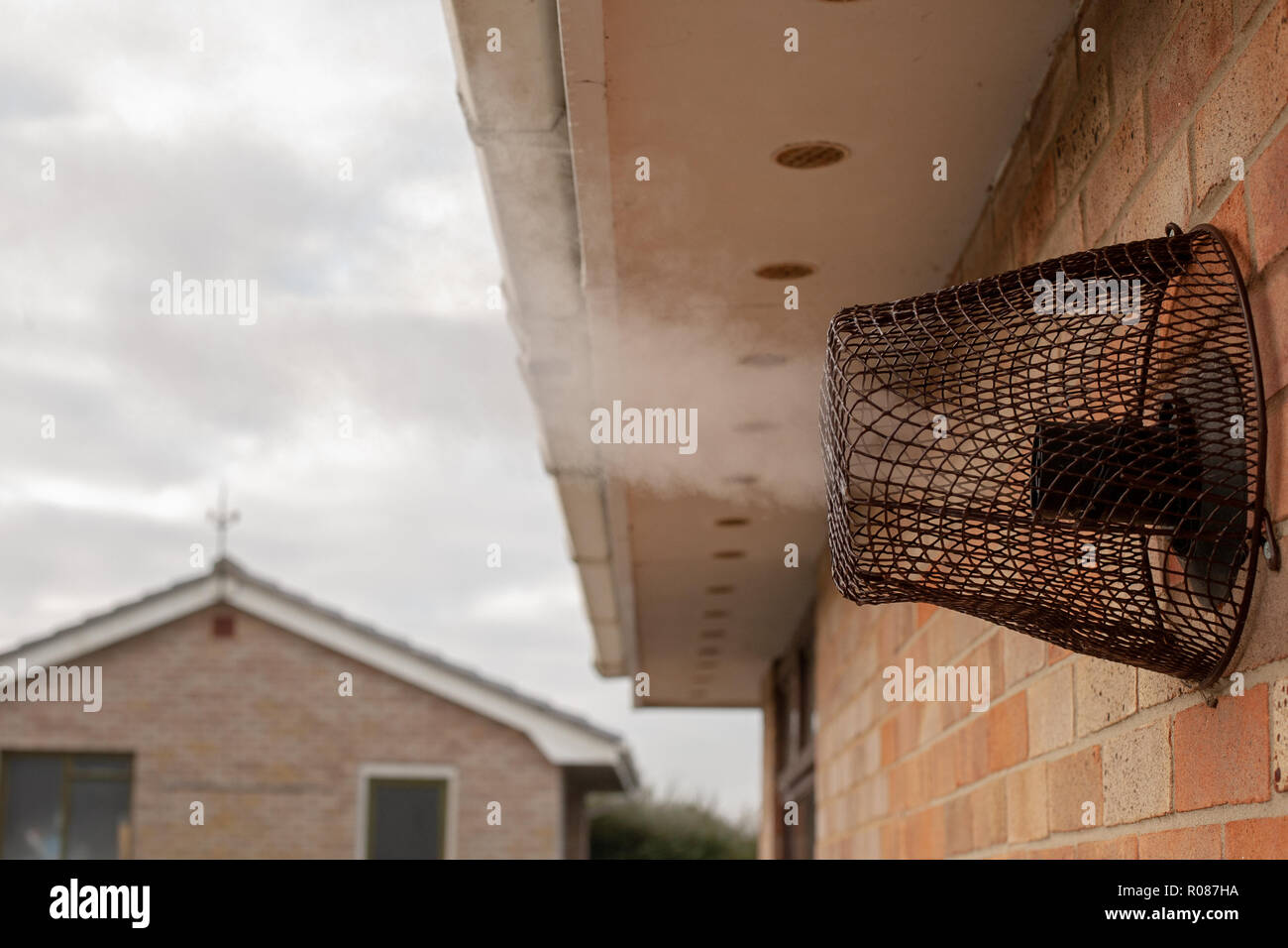Heating vent pushing out steam vapour in winter - Stock Image