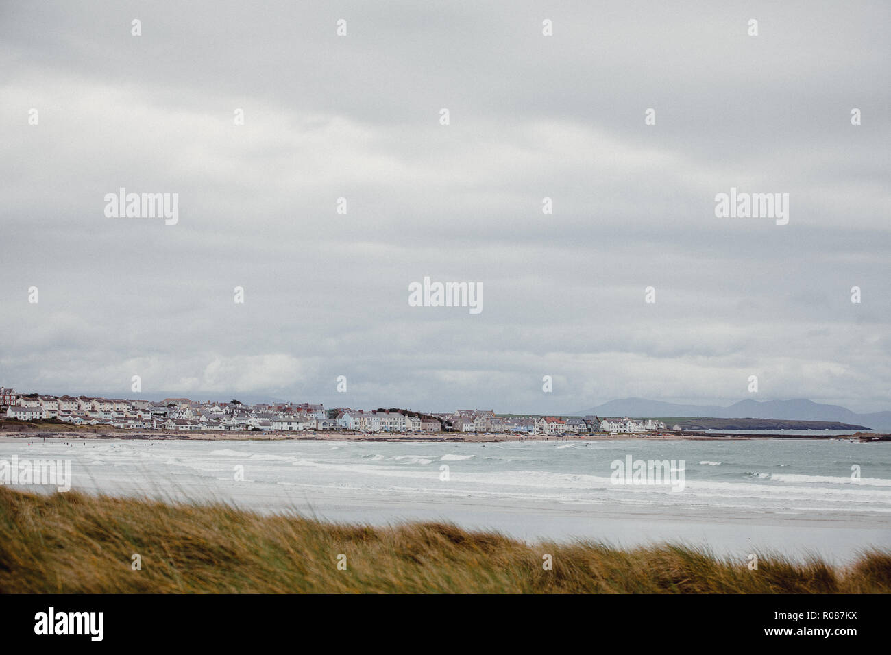 View of Rhosneigr from up in the sand dunes on Cymyran beach, Anglesey, North Wales, UK - Stock Image