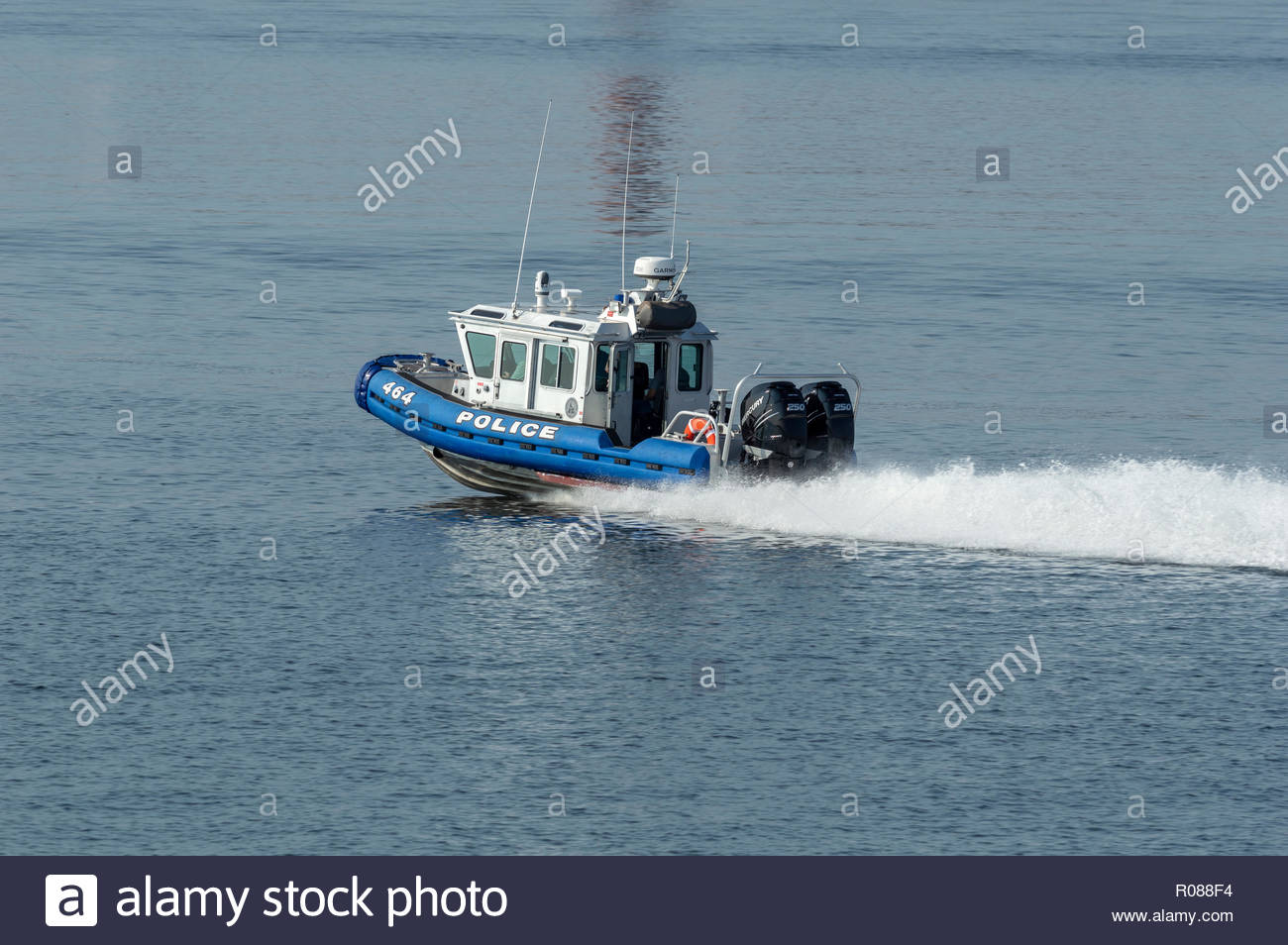 New Bedford, Massachusetts, USA - August 17, 2018: Twin 250-horsepower outboards driving Fairhaven Police Department patrol boat toward Buzzards Bay - Stock Image
