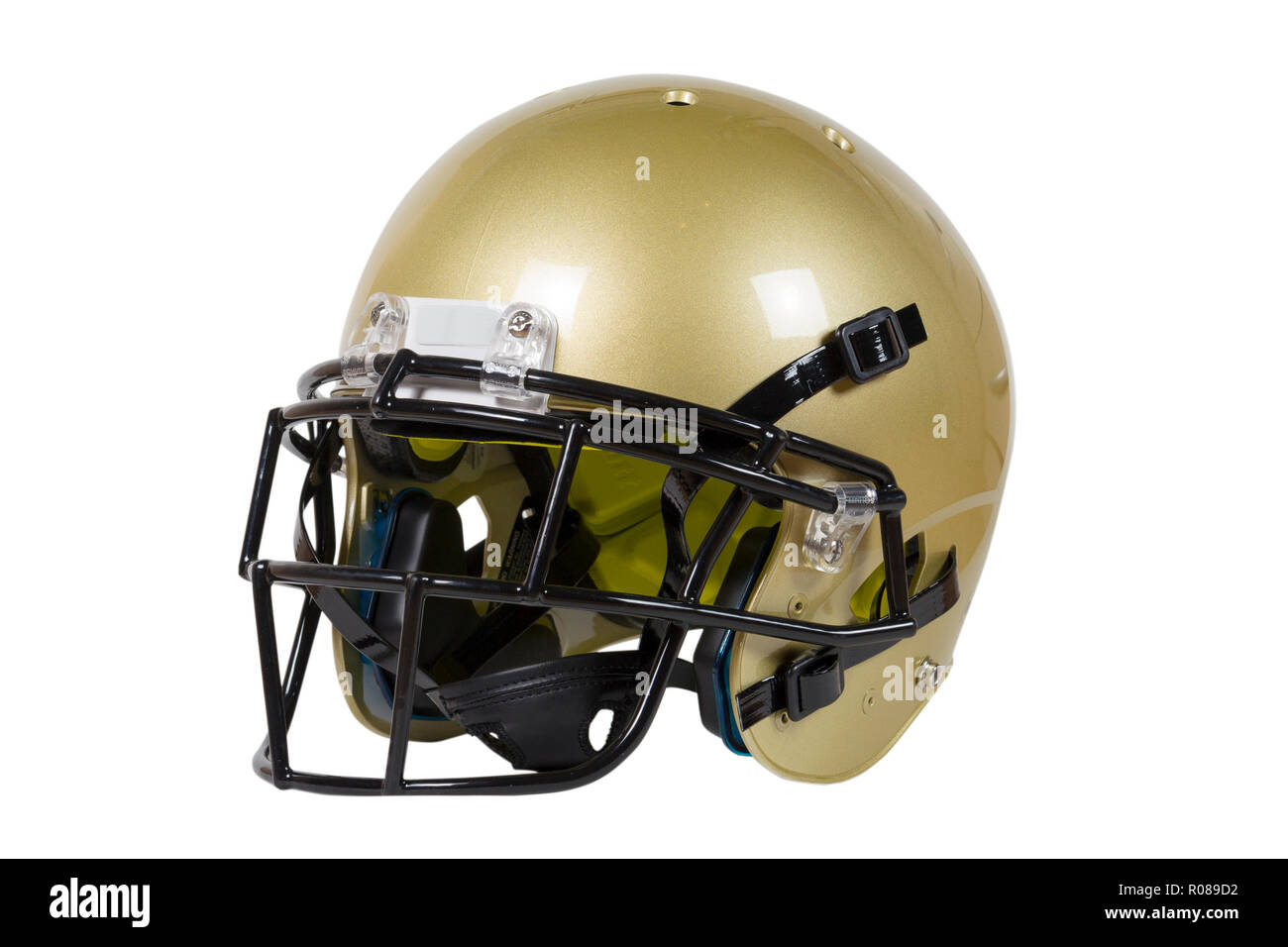 718b5a72 American football helmet isolated on white background with clipping path  Vegas Gold color - Stock Image