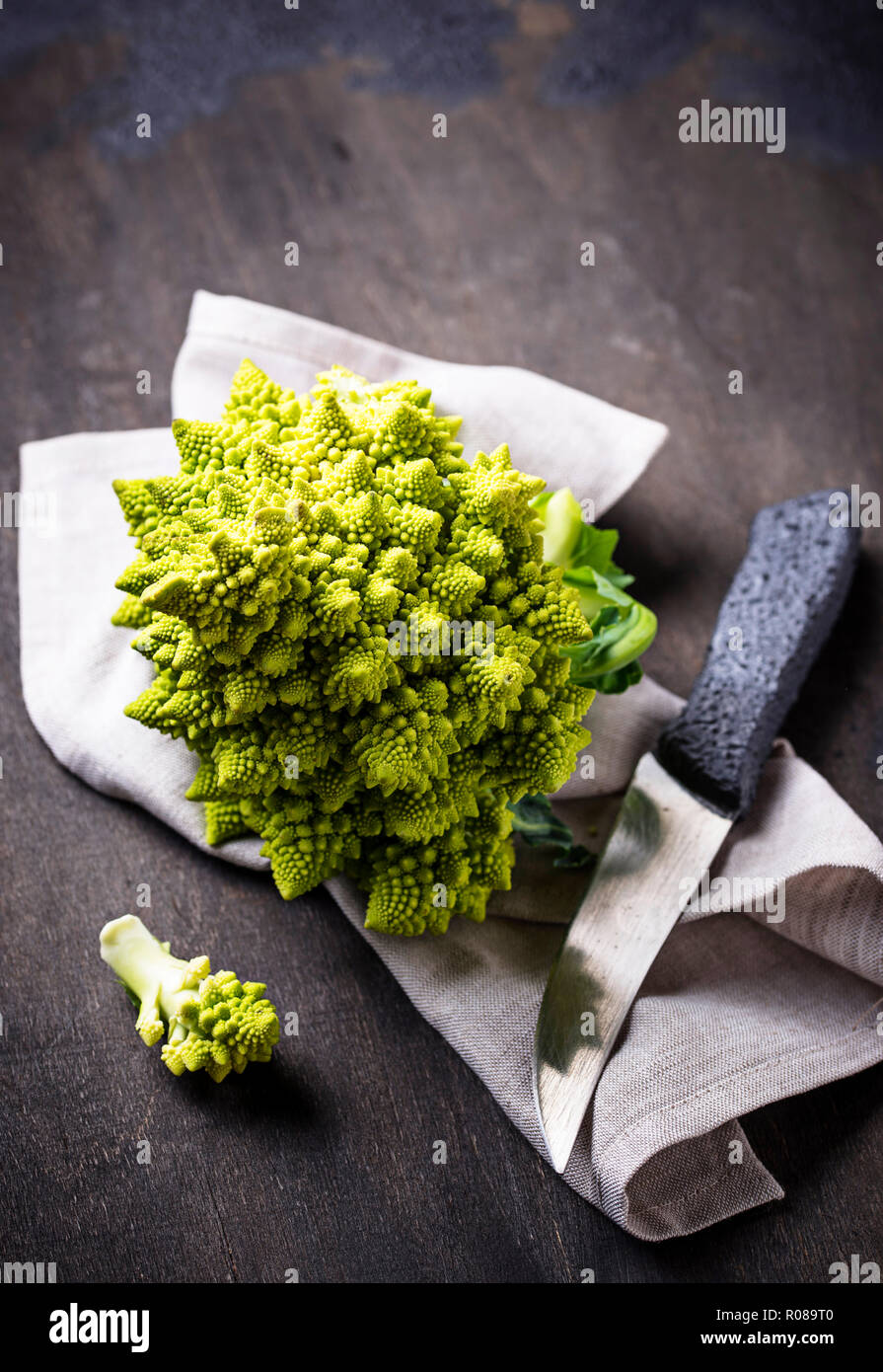 Romanesco broccoli on dark background - Stock Image