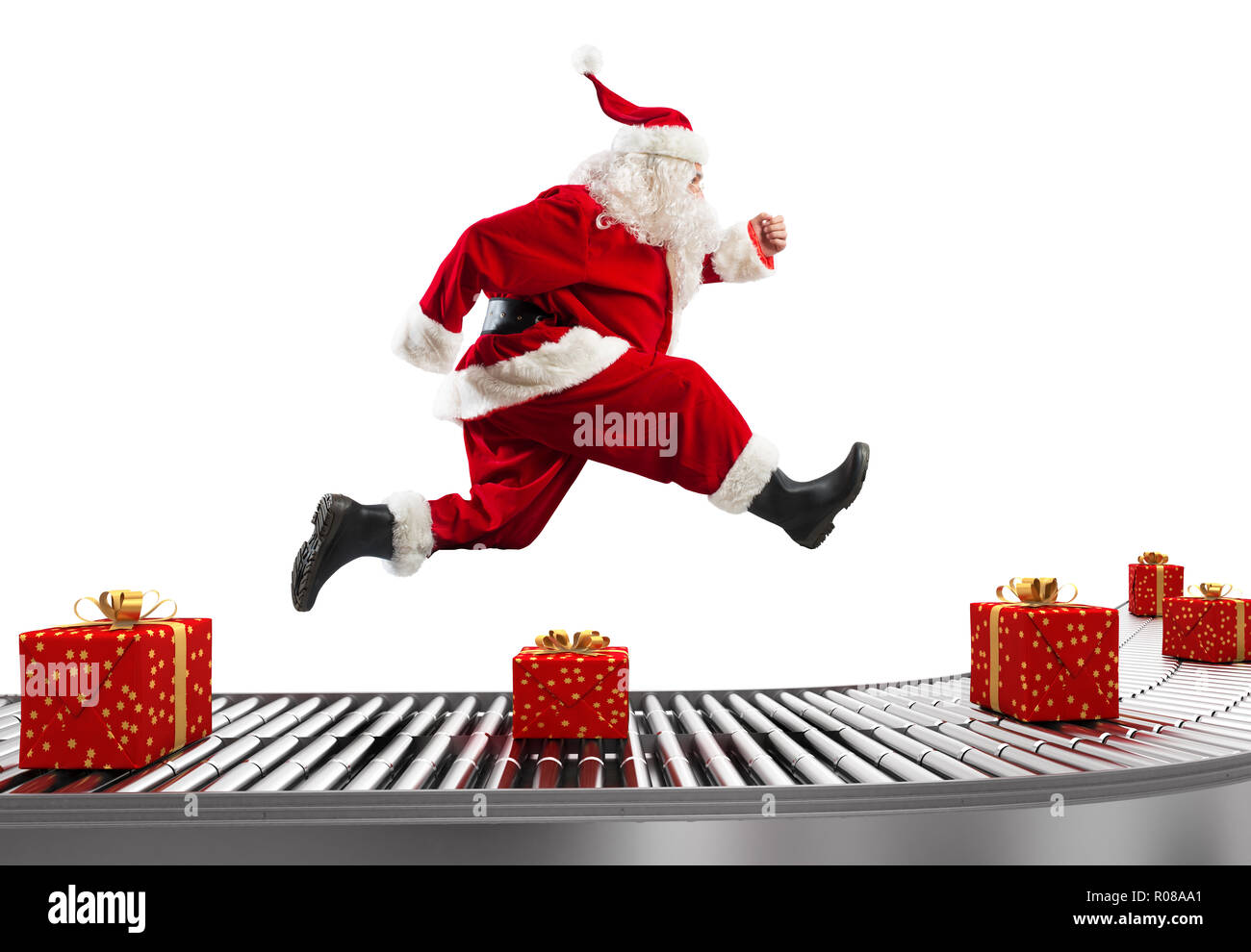 Santa Claus runs on the conveyor belt to arrange deliveries at Christmas time - Stock Image