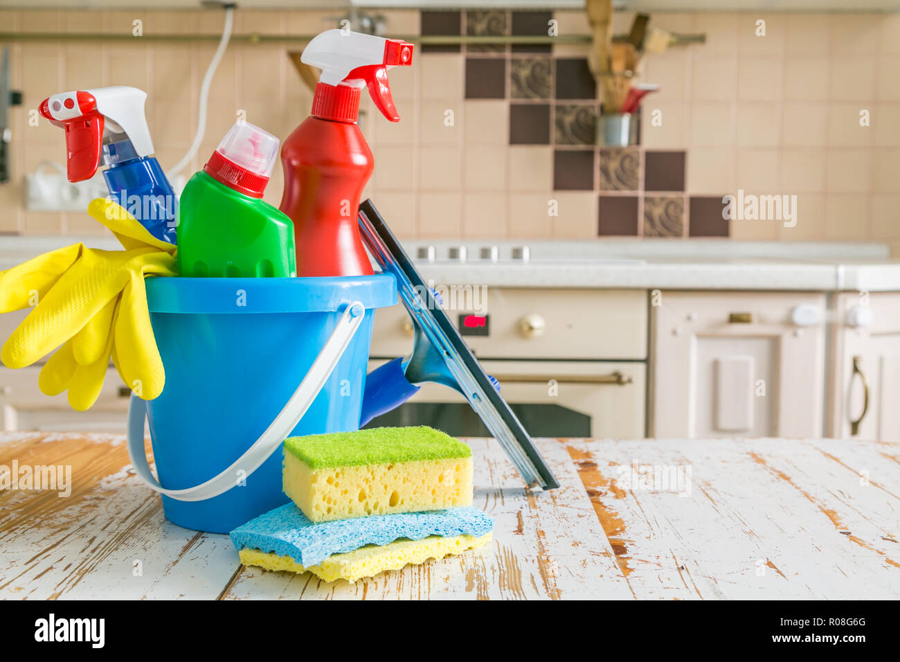 Cleaning concept - cleaning supplies, gloves, bottles on ...