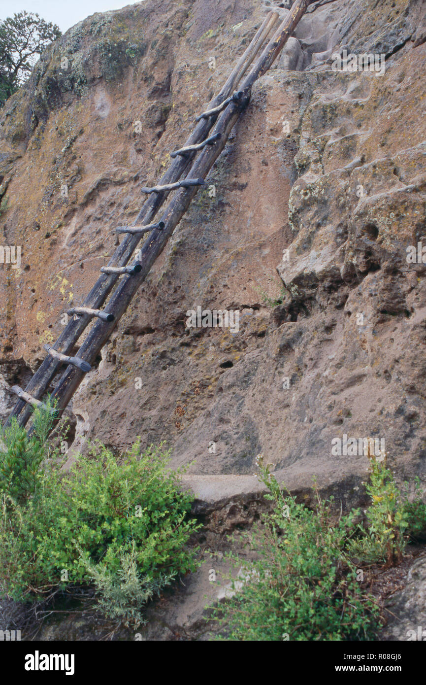 Ladder (reconstruction) used to climb between cliff-dwelling levels on Tsankawi mesa, New Mexico. Photograph Stock Photo