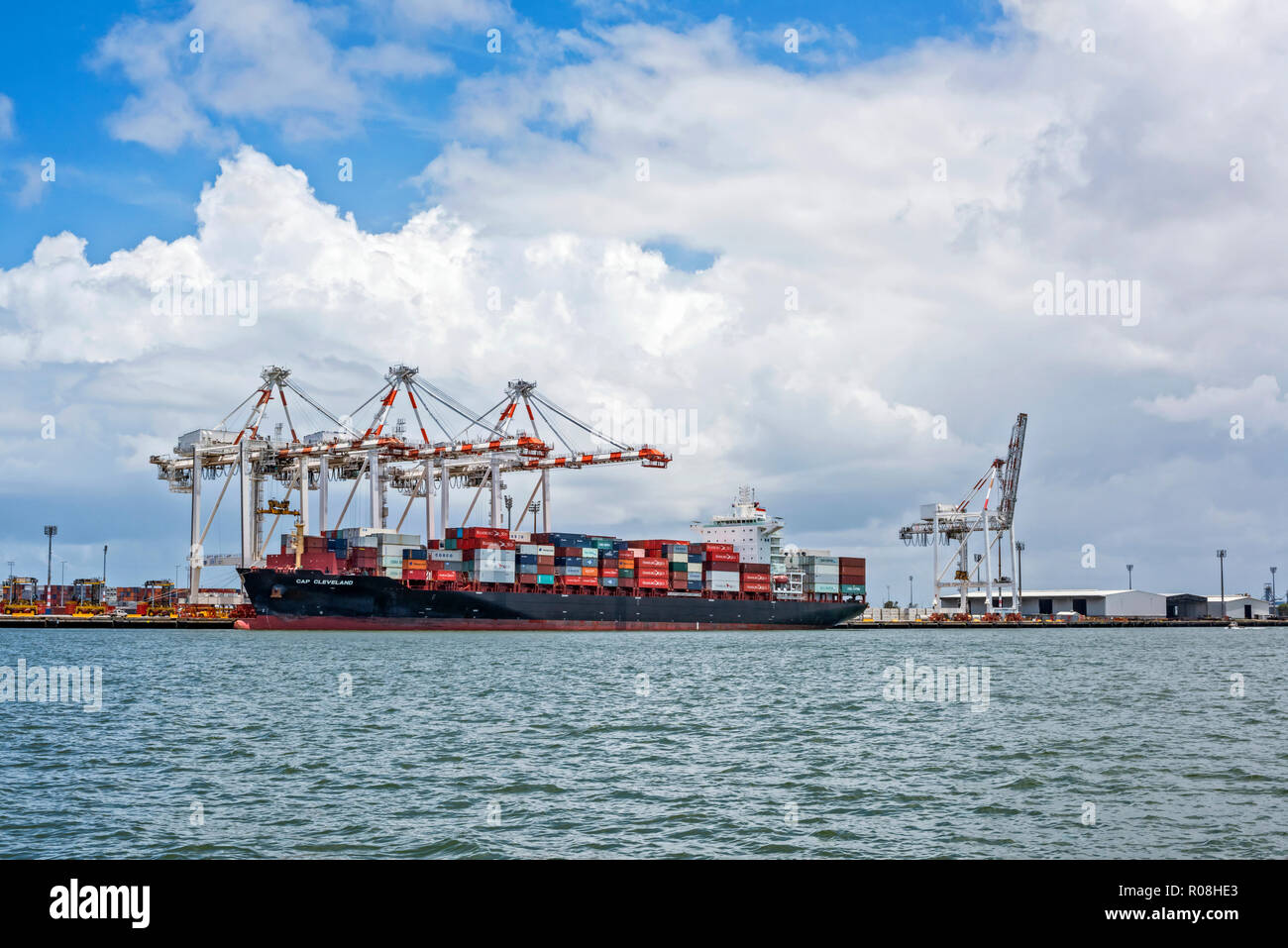 Container ship docket at terminal on Brisbane River. - Stock Image