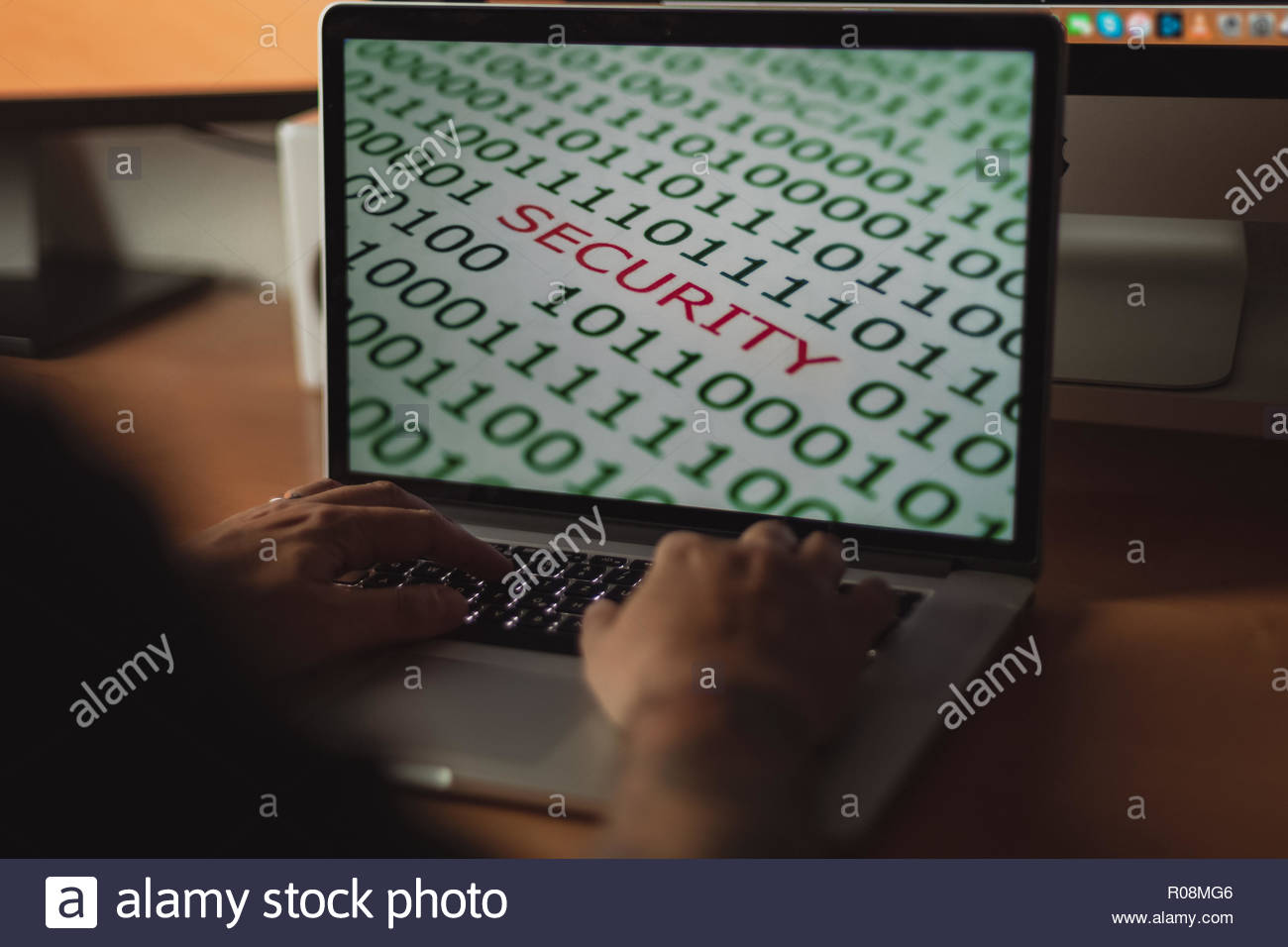 Man working on laptop for internet banking process security concept, wooden table - Stock Image
