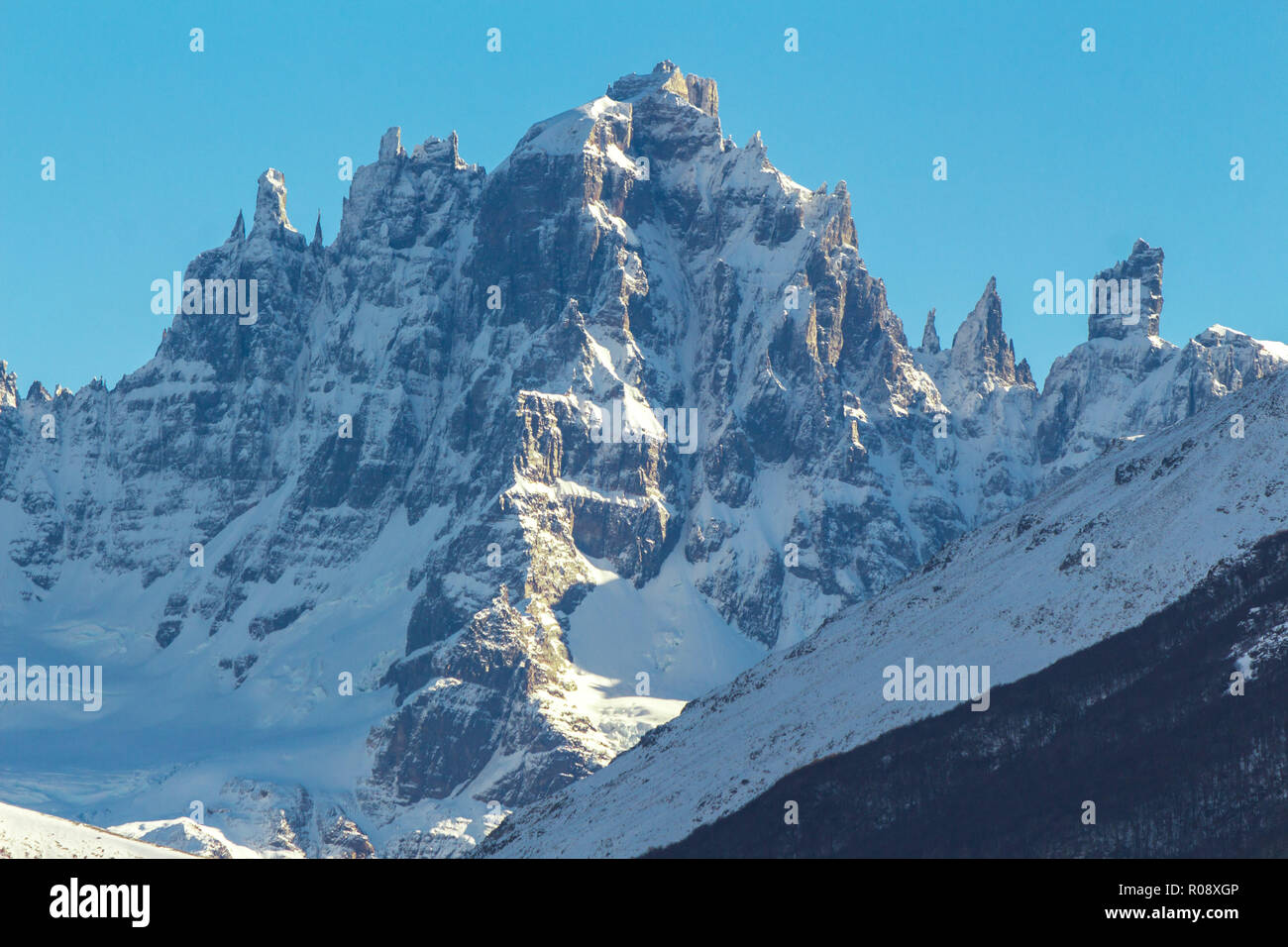 The snowy peack of Cerro Castillo mountain, which really looks like a castle, at carretera austral, the Route 7 at Chile - Stock Image