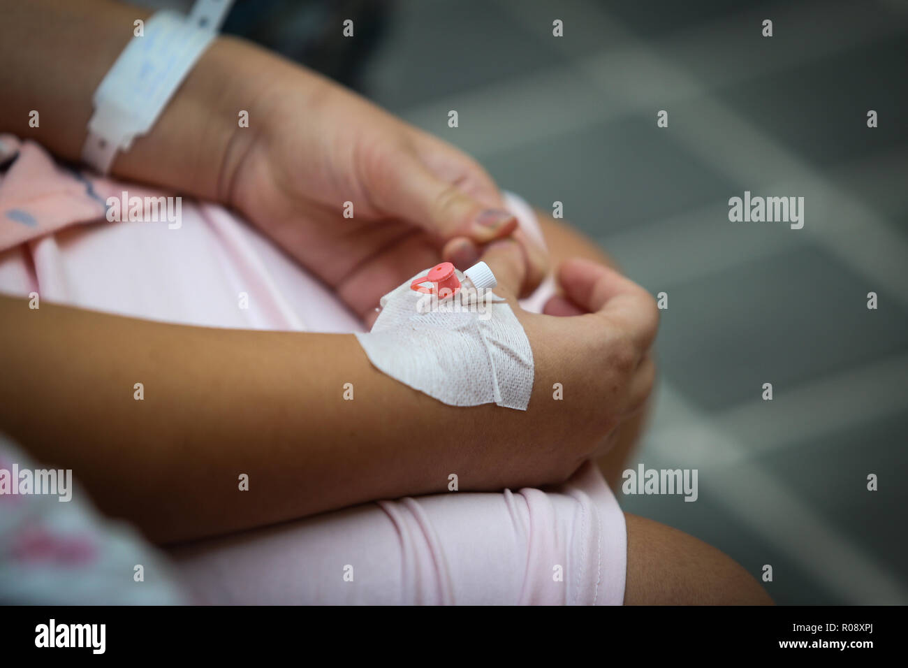 Details of a cannula on the hand of a pregnant woman in the hospital - Stock Image