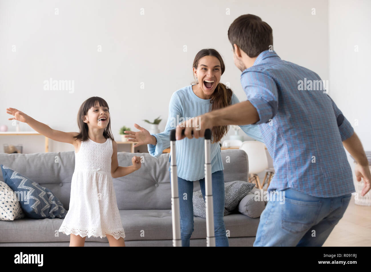 Father arrived at home with suitcase luggage from business trip - Stock Image
