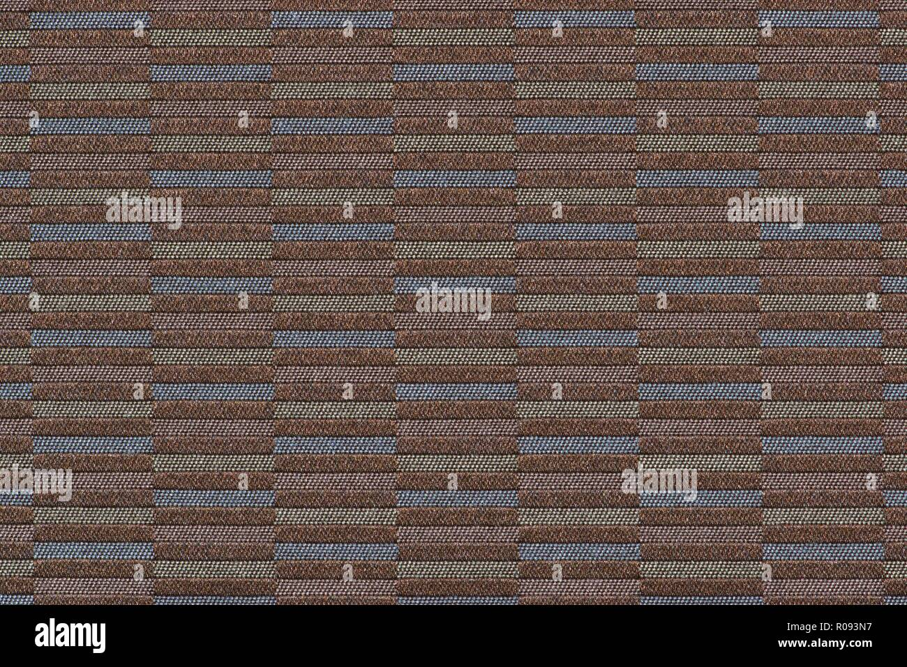 Multi-colored woven section of brown fabric showing horizontal bar patterns. - Stock Image