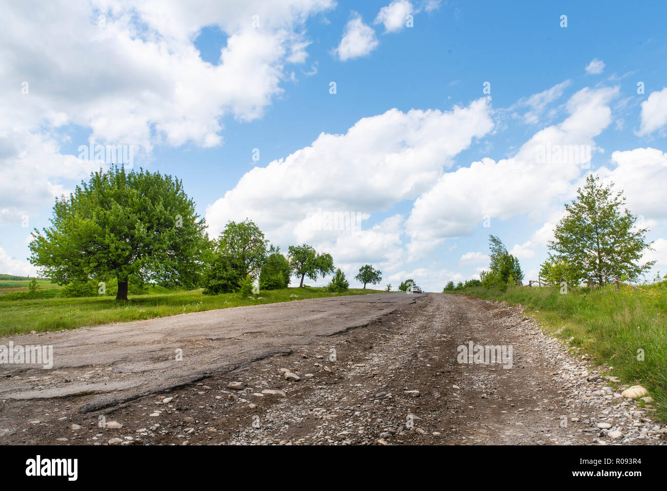 Completely destroyed road, difficult traffic area, threat of damage to vehicle. Countryside Stock Photo