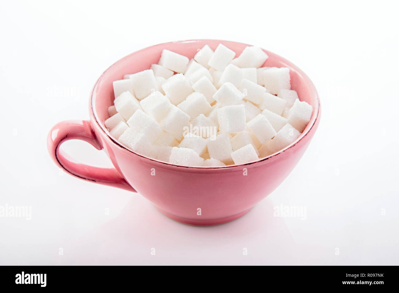 refined sugar in a cup - Stock Image