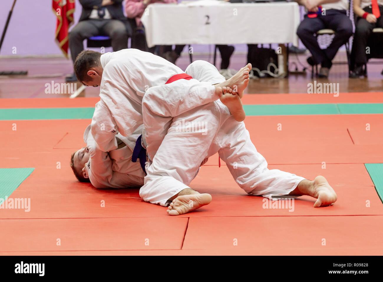 Russia, Vladivostok, 11/03/2018. Jiu-Jitsu wrestling competition among men. Martial arts and fighting sports tournament. - Stock Image