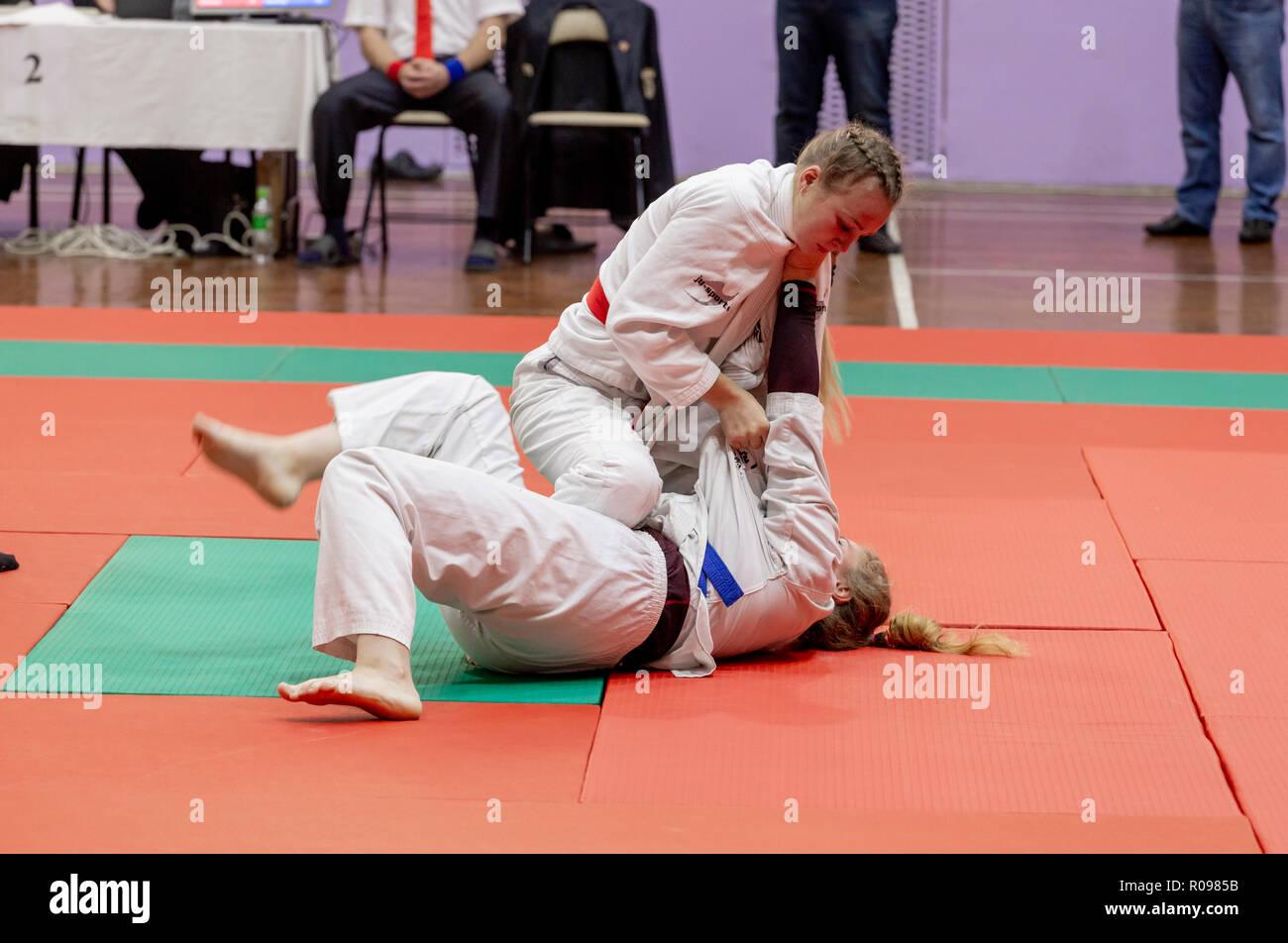 Russia, Vladivostok, 11/03/2018. Jiu-Jitsu wrestling competition among women. Martial arts and fighting sports tournament. - Stock Image