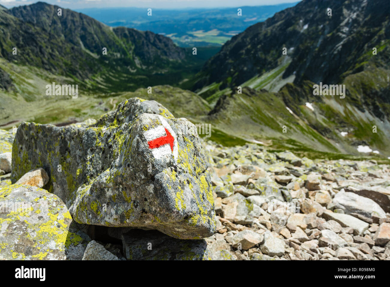 Marker with correct direction on high mountain trail below Koprovsky peak in High Tatras mountains in Slovakia - Stock Image