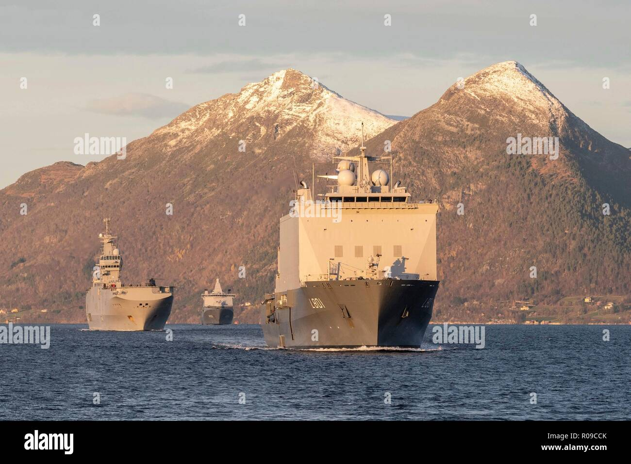 Molde Fjords, Norway. 01st Nov, 2018. The Royal Dutch Navy ship HNLMS Johan de Witt, right, escorts the French Naval ship Fs Dixmude in an Amphibious Assault during Exercise Trident Juncture 18 November 1, 2018 in Molde Fjords, Norway. The multi-national exercise is the largest NATO exercise since 2015, and includes more than 50,000 military members from 31 countries. Credit: Planetpix/Alamy Live News - Stock Image
