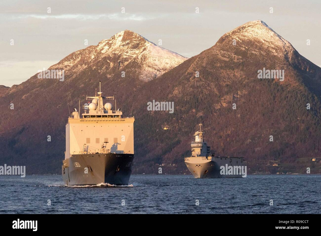 Molde Fjords, Norway. 01st Nov, 2018. The Royal Dutch Navy ship HNLMS Johan de Witt, left, escorts the French Naval ship Fs Dixmude in an Amphibious Assault during Exercise Trident Juncture 18 November 1, 2018 in Molde Fjords, Norway. The multi-national exercise is the largest NATO exercise since 2015, and includes more than 50,000 military members from 31 countries. Credit: Planetpix/Alamy Live News - Stock Image