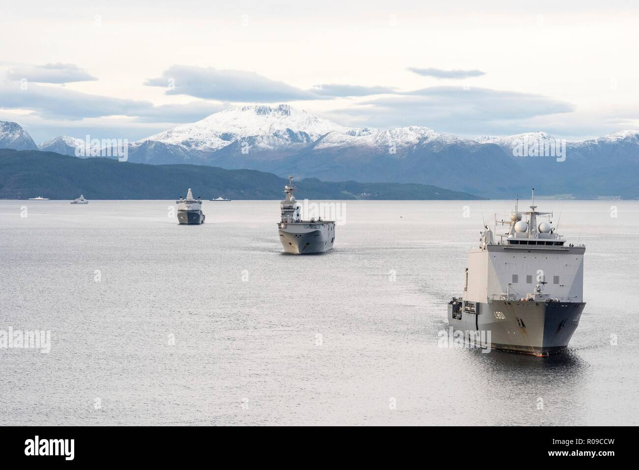 Molde Fjords, Norway. 01st Nov, 2018. The Royal Dutch Navy ship HNLMS Johan de Witt, right, escorts the French Naval ship FS Dixmude, center, followed by the HNLMS Karel Doormanin during an Amphibious Assault at Exercise Trident Juncture 18 November 1, 2018 in Molde Fjords, Norway. The multi-national exercise is the largest NATO exercise since 2015, and includes more than 50,000 military members from 31 countries. Credit: Planetpix/Alamy Live News - Stock Image