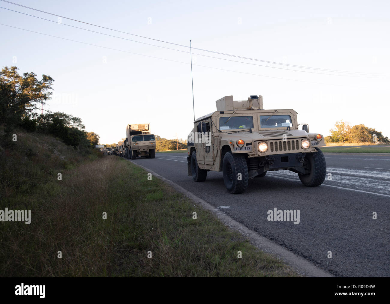 United States Army convoy carries troops and supplies to the U.S.-Mexico border on orders of Pres. Donald Trump. The president sent troops to the border in response to his perception of a group of refugees, fleeing violence and poverty in Honduras and trying to reach the relative safety of the United States, as a national security threat. Stock Photo