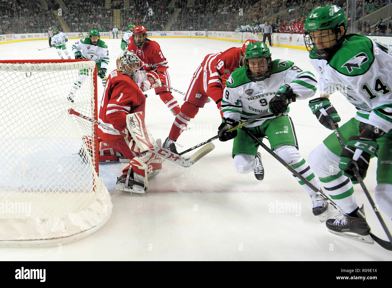 North Dakota, USA. 2 November 2018.  North Dakota Fighting Hawks forward Jasper Weatherby (14) and North Dakota Fighting Hawks forward Dixon Bowen (9) race after the puck during a NCAA men's college hockey game between the Wisconsin Badgers and the University of North Dakota Fighting Hawks at Ralph Engelstad Arena in Grand Forks, ND. North Dakota won 5-0. Photo by Russell Hons/CSM Credit: Cal Sport Media/Alamy Live News - Stock Image