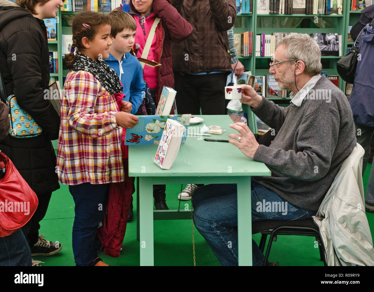 The children's author Michael Rosen signing books for young fans at the Hay Festival, Hay-on-Wye, Powys, UK - Stock Image