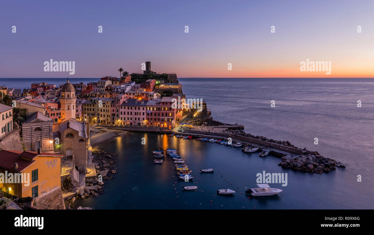 Colorful aerial view of the historic center of Vernazza after sunset, Cinque Terre park, Liguria, Italy - Stock Image