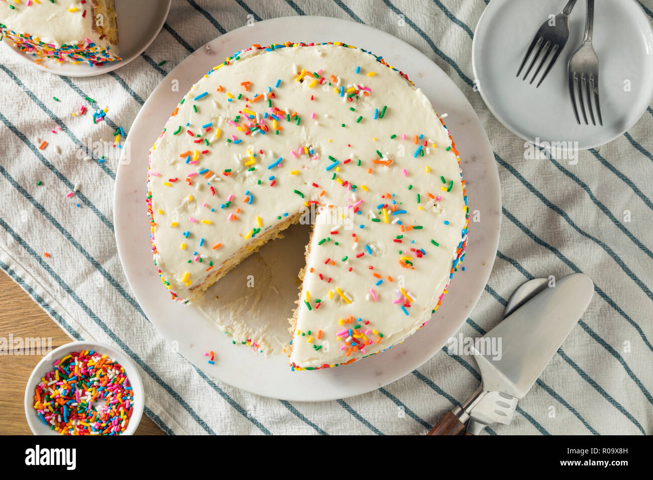 Homemade Sweet Birthday Cake with Candles Ready to Serve - Stock Image