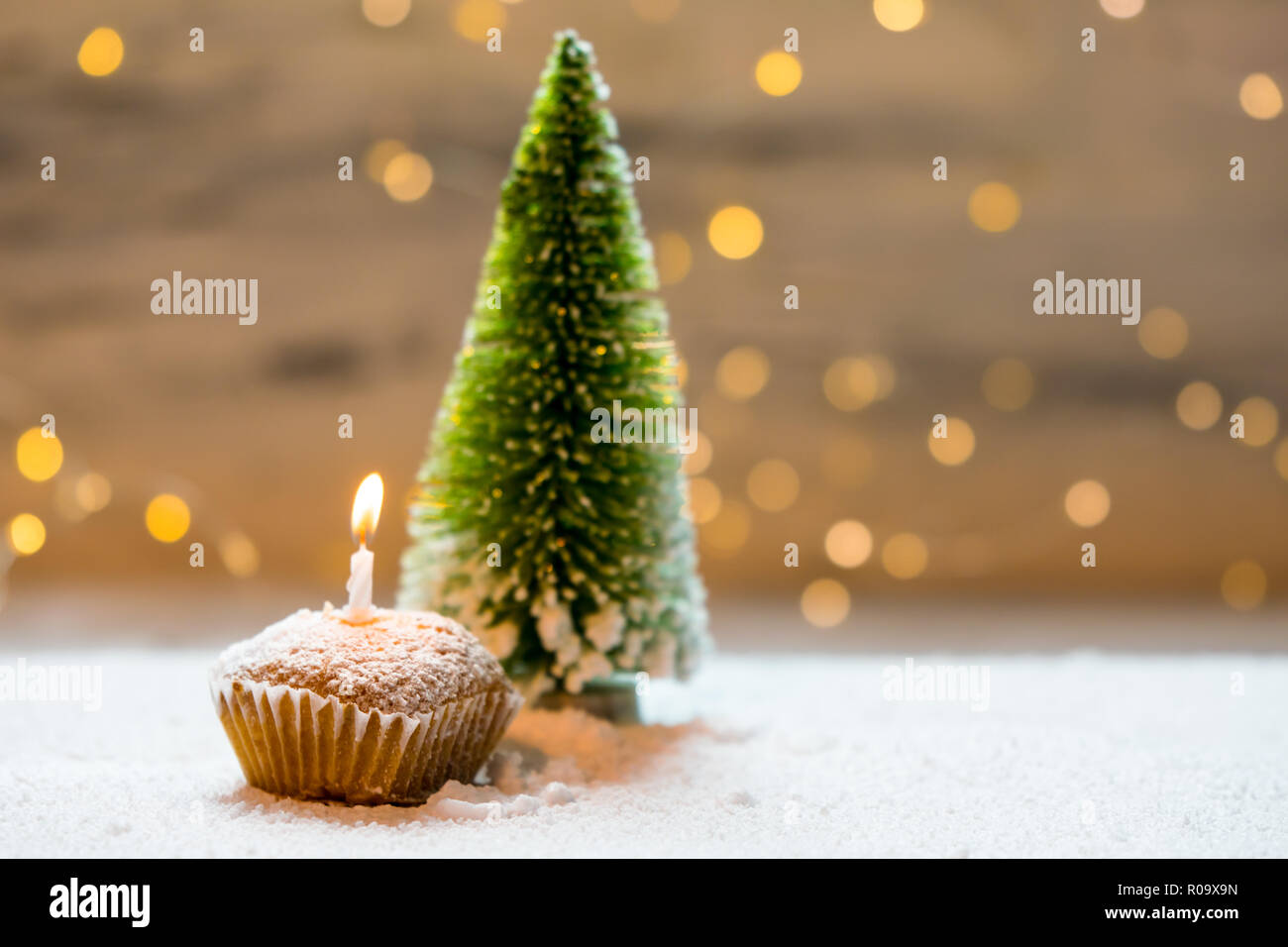 Cupcake With Candle On Winter Background Stock Photo Alamy
