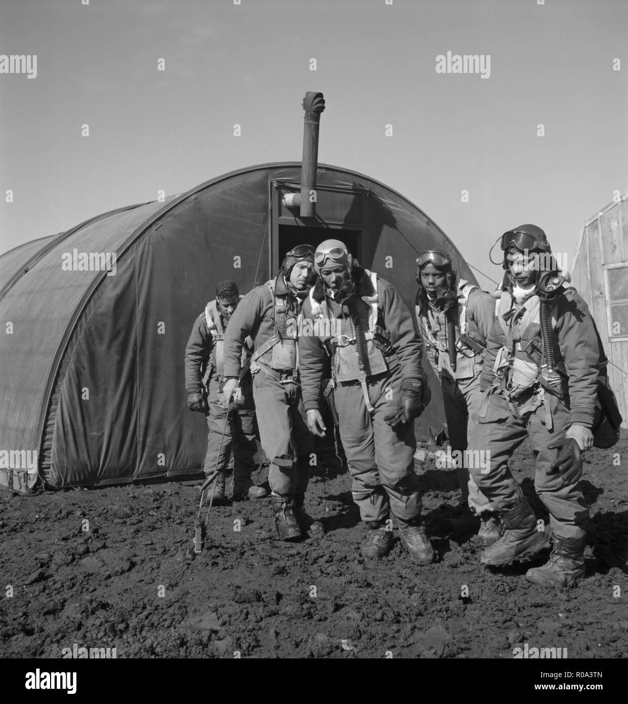Tuskegee Airmen Leaving Parachute Room, Left to right: Richard S. Harder, Brooklyn, NY, Class 44-B; Unidentified Airman; Thurston L. Gaines, Jr., Freeport, NY, Class 44-G; Newman C. Golden, Cincinnati, OH, Class 44-G; Wendell M. Lucas, Fairmont Heights, MD, Class 44-E, Ramitelli, Italy, Toni Frissell, March 1945 Stock Photo