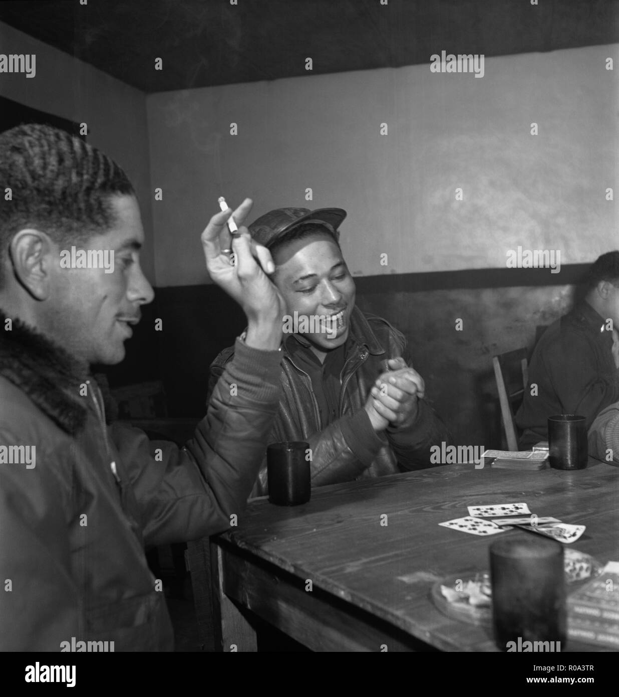 Tuskegee Airmen Playing Cards in Officers' Club, left to right: Walter M. Downs, New Orleans, LA, Class 43-B and William S. Price, III, Topeka, KS, Class 44-C, Ramitelli, Italy, Toni Frissell, March 1945 - Stock Image