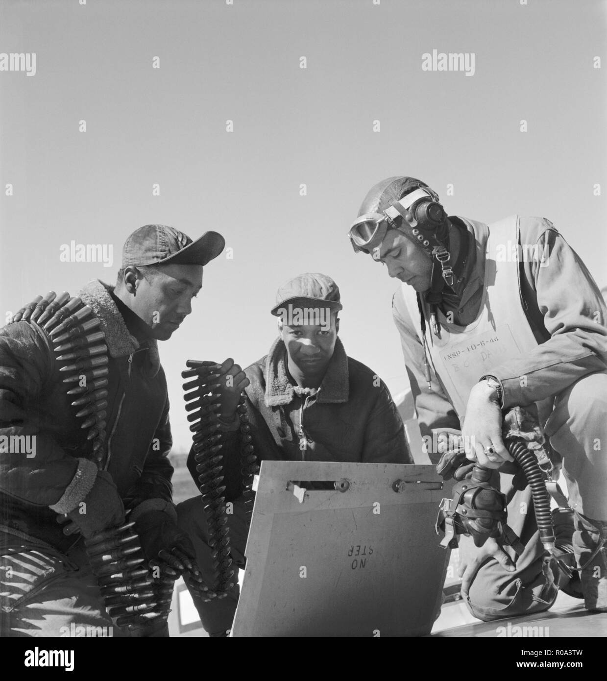 Tuskegee Airmen, left to right, Roscoe C. Brown, New York, NY, Class 44-C; Marcellus G. Smith, Louisville, KY; Col. Benjamin O. Davis, Ramitelli, Italy, Toni Frissell, March 1945 - Stock Image