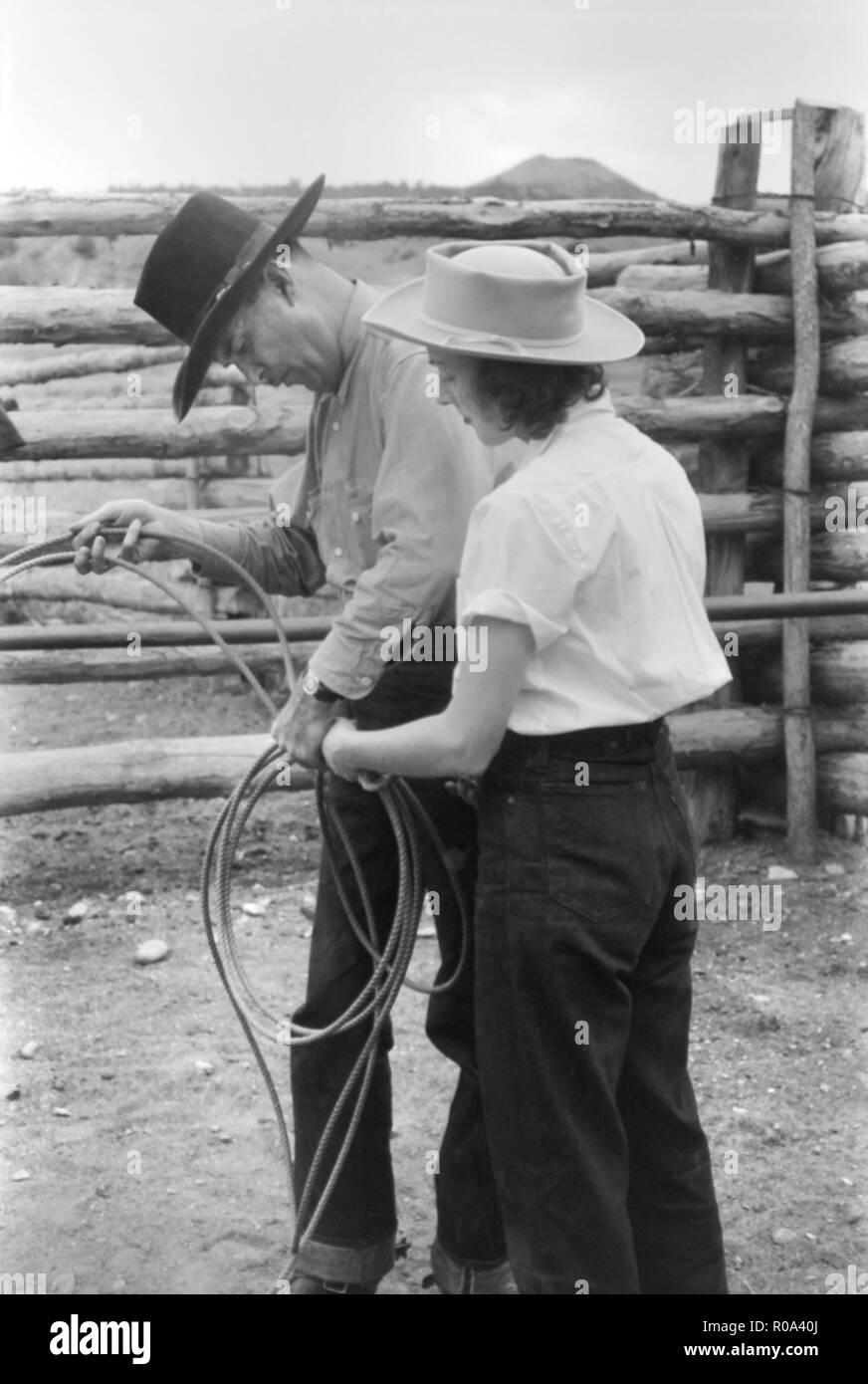 Learning how to Throw a Rope during Ranch Rodeo Contest, Brewster Arnold Quarter Circle U Ranch, Birney, Montana, USA, Arthur Rothstein, Farm Security Administration, June 1939 - Stock Image