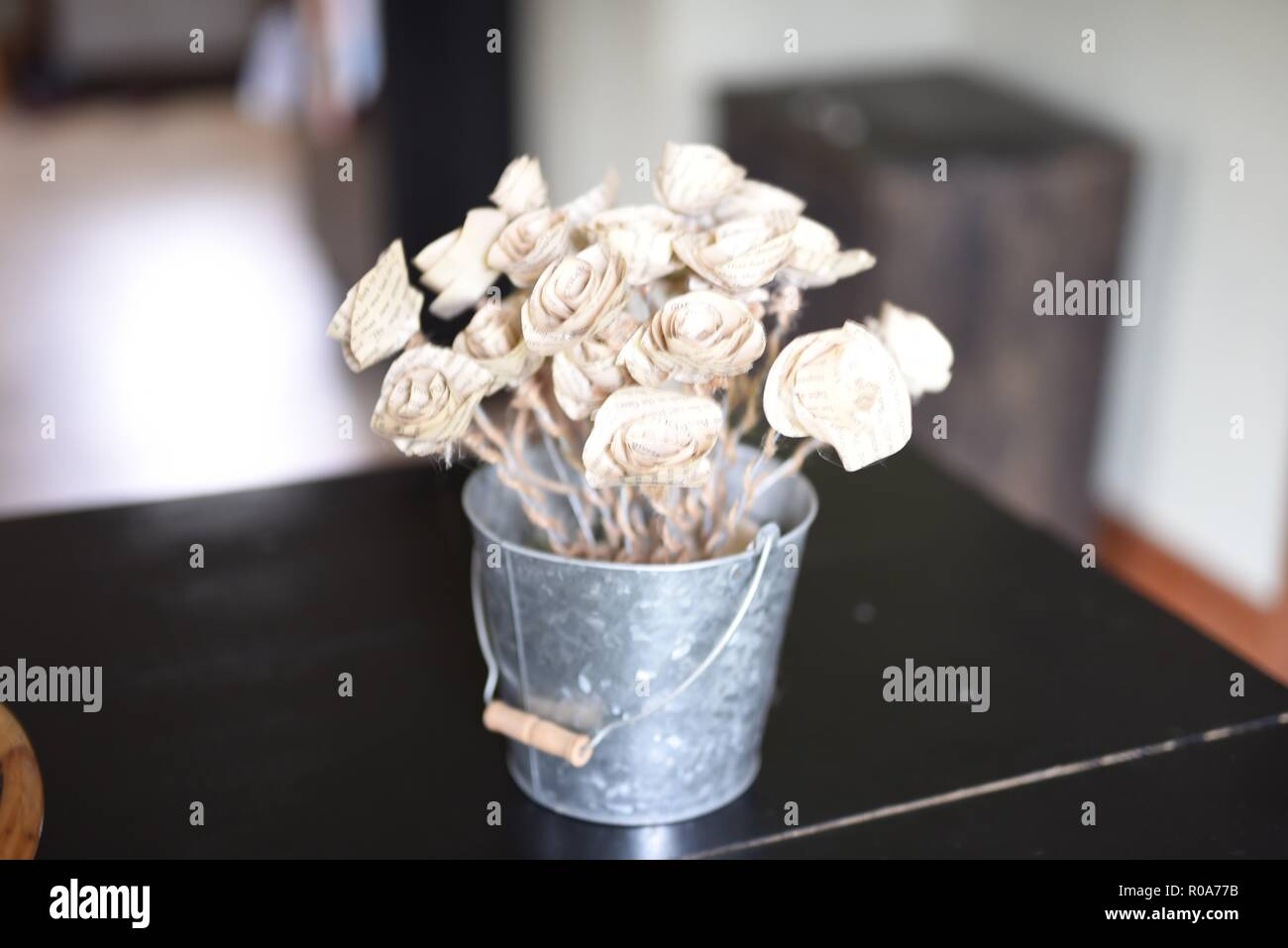 Paper Flowers Made Out Of Old Book Pages In A Gray Tin Bucket