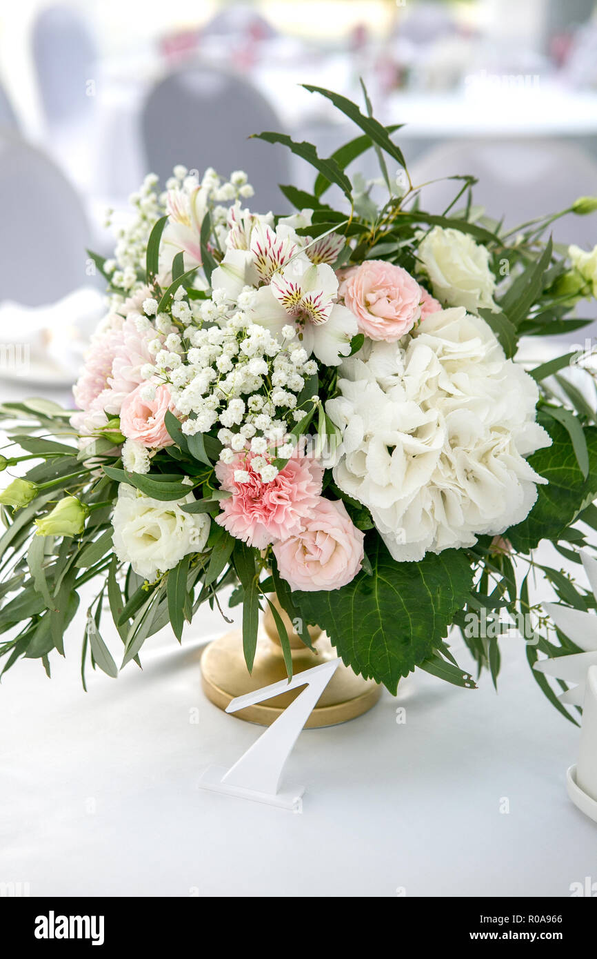 Beautiful White Dinner Table For Guests Decorated With Greenery And Long  Cloth. Flower Arrangement Of Hydrangeas, Roses, Gipsophiles, Lilies And  Green