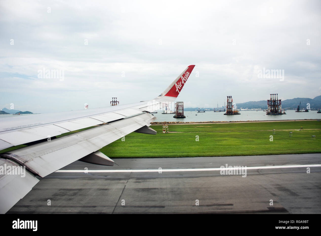Airbus landing on runway for bring Chinese people and foreigner travelers from Bangkok at Hong Kong International Airport on September 3, 2018 in Hong - Stock Image