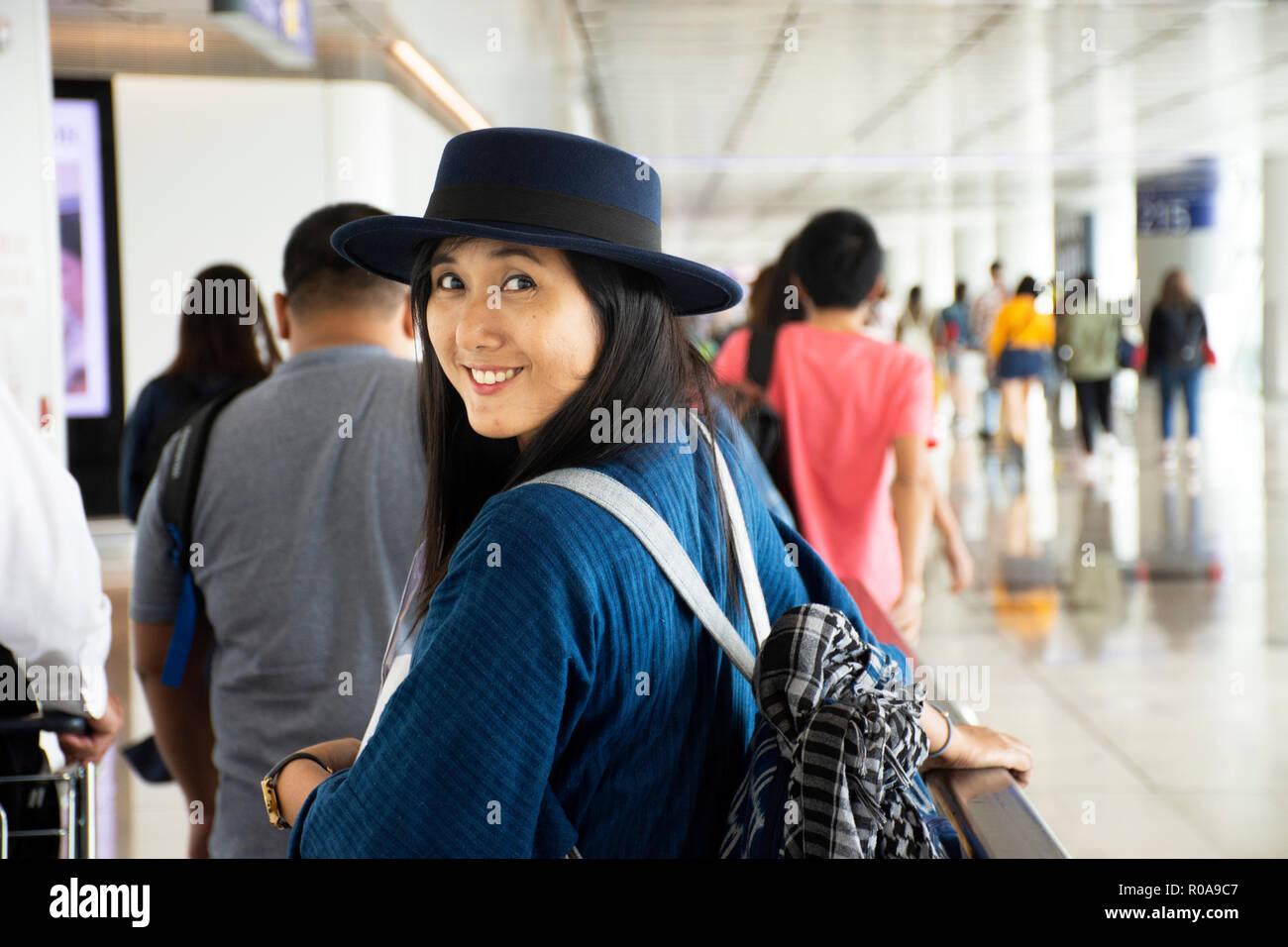Travelers thai woman walking in terminal go to bus station at Hong Kong International Airport or Chek Lap Kok Airport on September 3, 2018 in Hong Kon - Stock Image