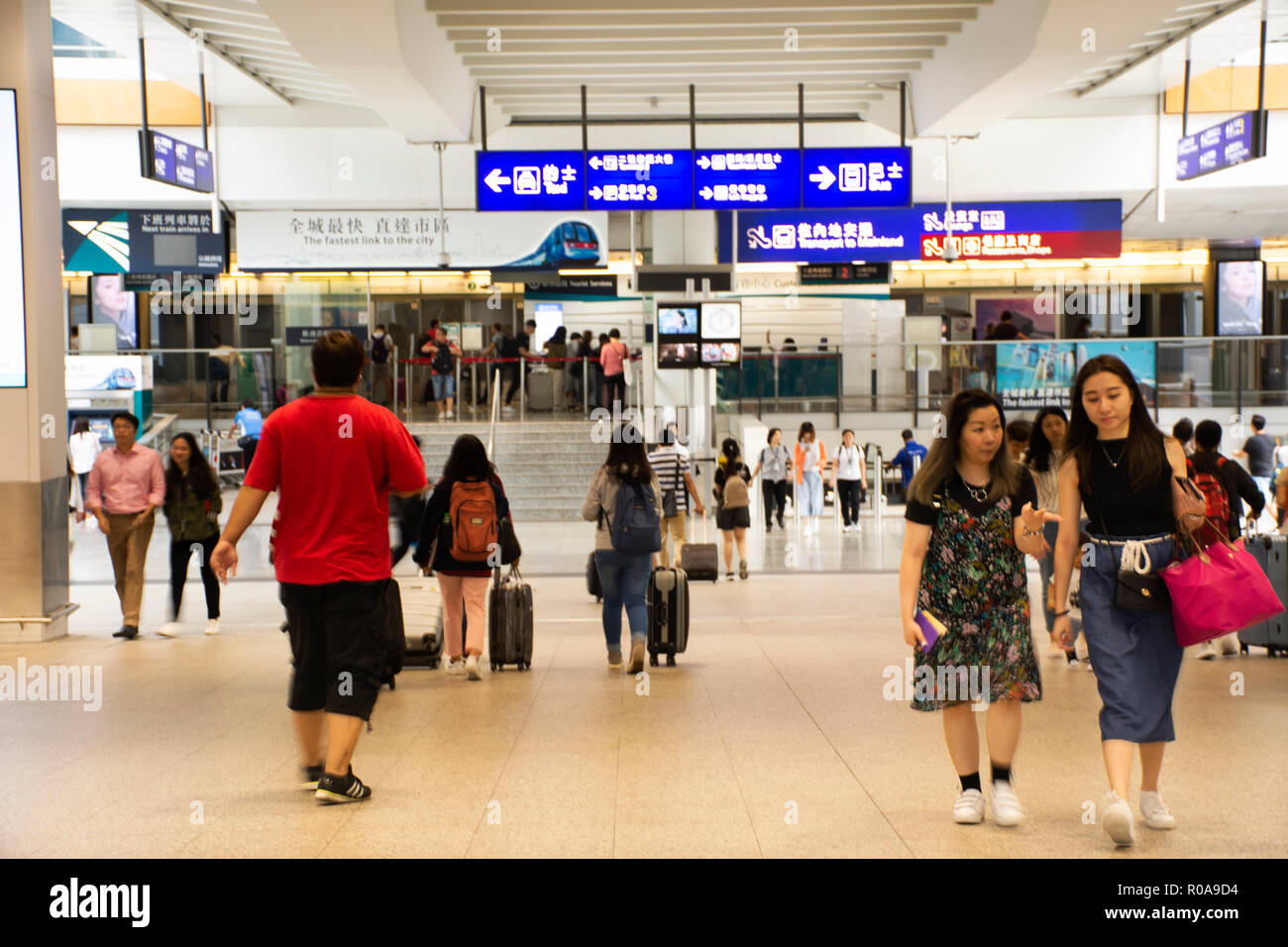 Chinese people and foreigners traveler walking in terminal of Hong Kong International Airport or Chek Lap Kok Airport on September 3, 2018 in Hong Kon - Stock Image