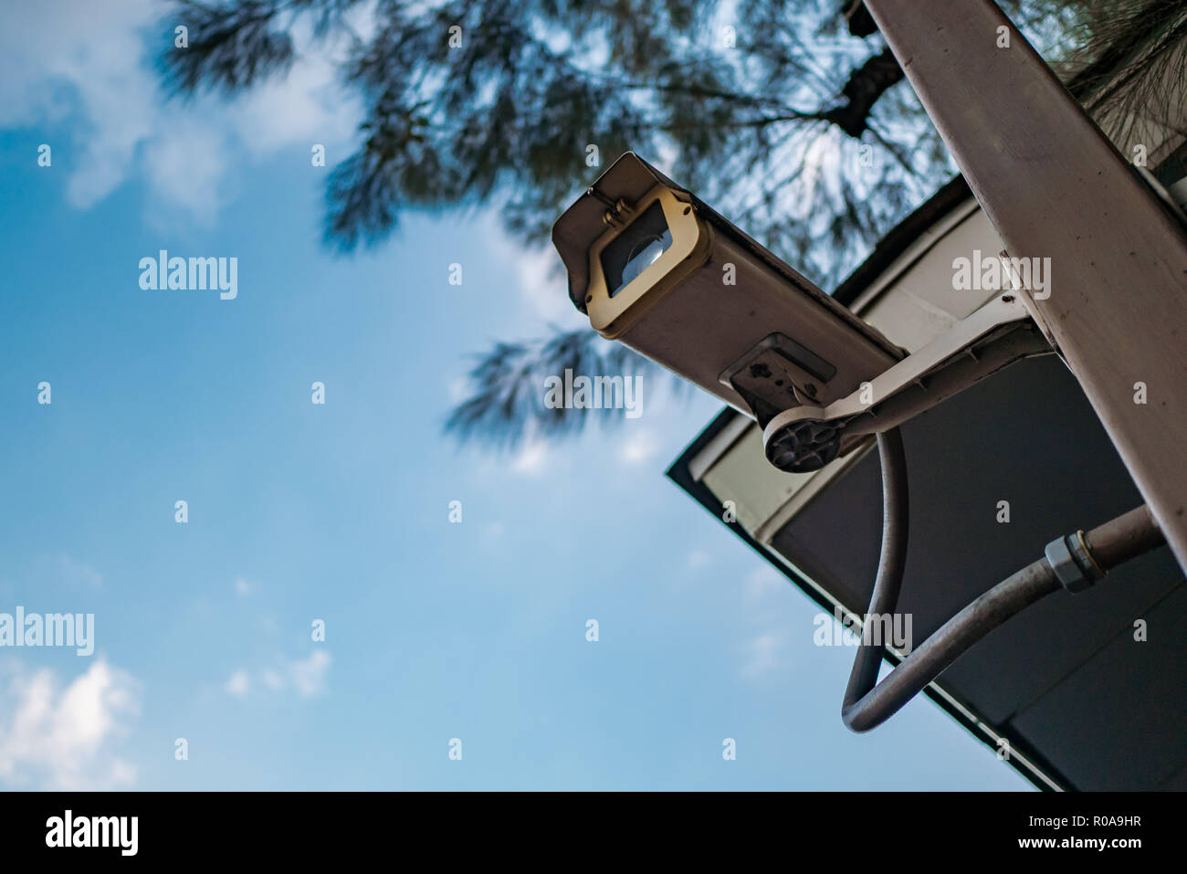 Surveillance camera in public space - Stock Image