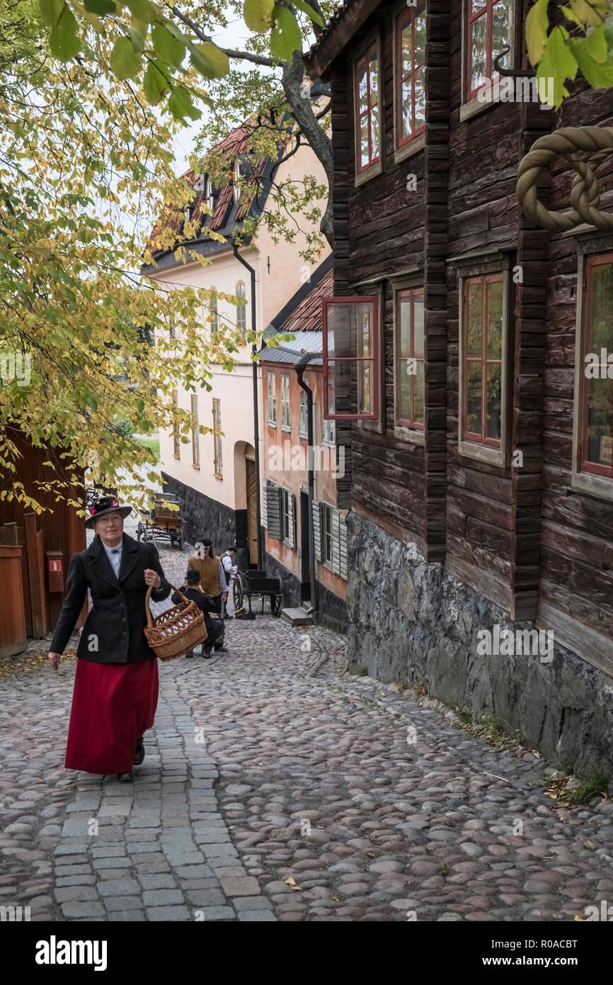 Skansen open air museum, Djurgarden, Sweden. Re-enactors illustrate pre industrial life in early towns and villages. - Stock Image
