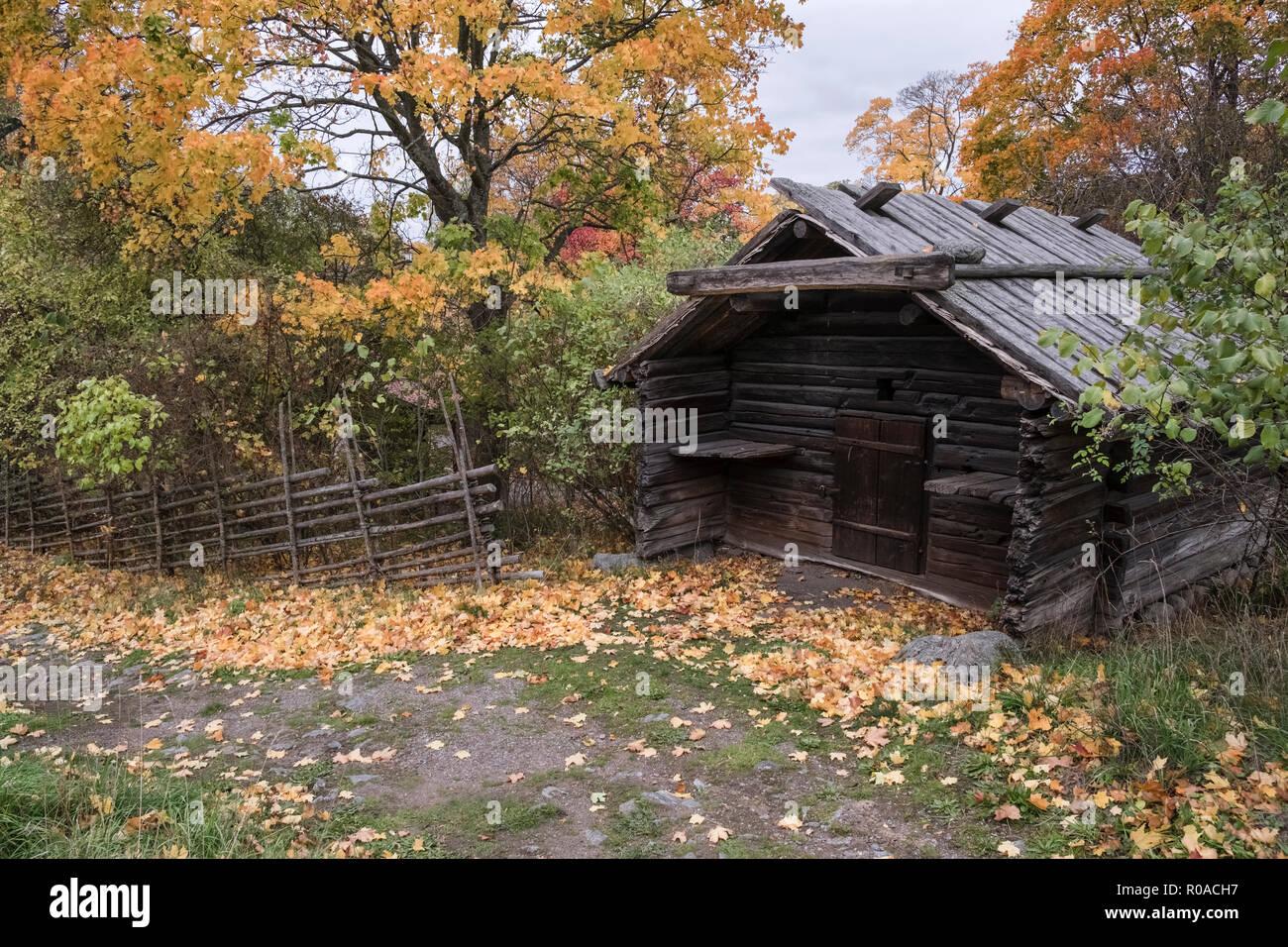 Example of traditional pre industrial wooden cabin building at Skansen open air museum, October, Djurgarden, Stockholm, Sweden. - Stock Image
