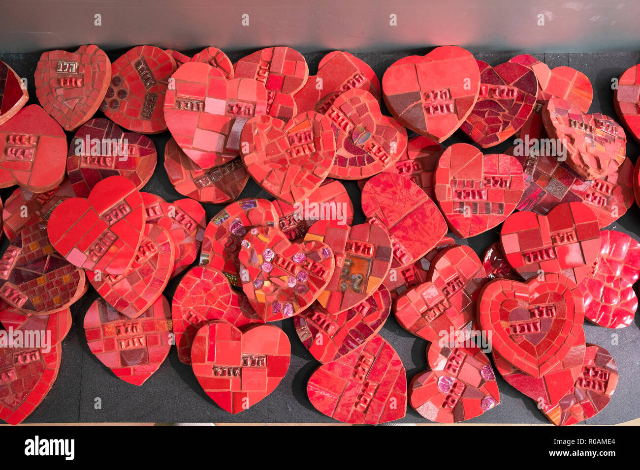 Some of the 27,000 ceramic hearts on display at the Rabin Center to commemorate Israelis killed in wars and terrorist attacks. In Tel Aviv, Israel - Stock Image